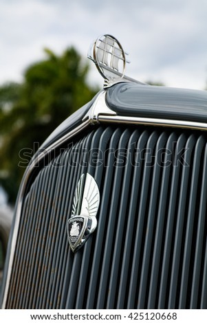 Miami, Florida USA - February 28, 2016: Close up view of the front end of a beautifully restored 1934 American Plymouth automobile. - stock photo