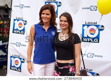 Miami, Florida, USA- March 7, 2015: Three-time Emmy Award winning reporter, Laurie Jennings (left), greets a fan at the Carnaval On The Mile Festival in Miami, Florida. - stock photo