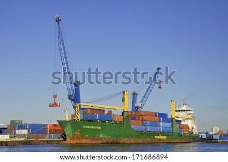 MIAMI, FLORIDA - USA - OCTOBER 31: Cargo boat wait for load containers inside on October 31 2012 in Miami Florida USA .The Port of Miami accounts for 176,000 jobs - stock photo
