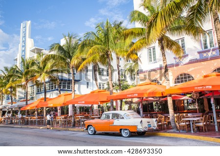 MIAMI, FLORIDA - View along Ocean Drive along South Beach Miami in the historic Art Deco District with hotels, restaurant and classic car