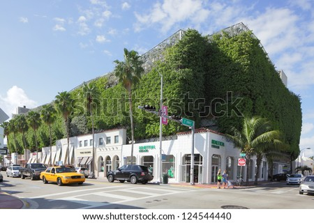 MIAMI - JANUARY 12: Eco-friendly parking garage and retail shops at 700 Collins Ave January 12, 2013 in Miami, Florida. - stock photo