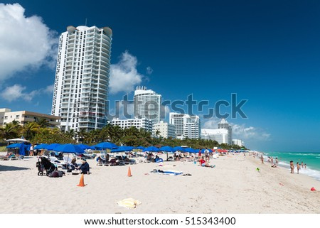 MIAMI - JANUARY 2016: People relax on South Beach. Miami Beach is a popular destination for locals and tourists.