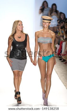 MIAMI - JULY 21: A model is walking the runway at L*Space By Monica Wise for 2014 collection during Mercedes-Benz Fashion Week Swim on July 21, 2013 in Miami