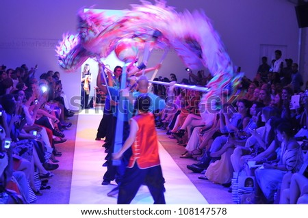 MIAMI - JULY 19: Dragon dancers on runway at the Lisa Blue Collection for Spring/ Summer 2013 during Mercedes-Benz Swim Fashion Week on July 19, 2012 in Miami, FL - stock photo
