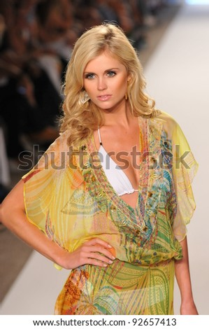 MIAMI - JULY 16: Model walking runway at the Caffe Swimwear Collection for Spring/ Summer 2012 during Mercedes-Benz Swim Fashion Week on July 16, 2011 in Miami, FL - stock photo