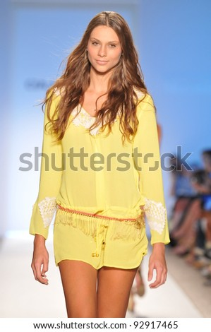 MIAMI - JULY 17: Model walking runway at the Cia Maritima Collection for Spring/ Summer 2012 during Mercedes-Benz Swim Fashion Week on July 17, 2011 in Miami, FL - stock photo