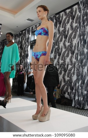 MIAMI - JULY 21: Model walks at the Kooey Swimwear Presentation for Spring/ Summer 2013 during Mercedes-Benz Swim Fashion Week on July 21, 2012 in Miami, FL - stock photo