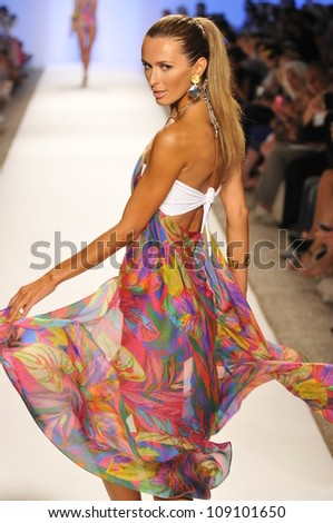 MIAMI - JULY 21: Model walks runway at the Caffe Swimwear Collection for Spring/ Summer 2013 during Mercedes-Benz Swim Fashion Week on July 21, 2012 in Miami, FL