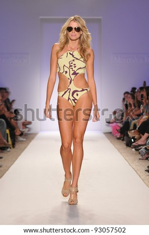 MIAMI - JULY 18: Model walks runway at the Jogo Beach Collection for Spring/ Summer 2012 during Mercedes-Benz Swim Fashion Week on July 18, 2011 in Miami, FL - stock photo