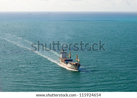 MIAMI - MAY 4: A container ship starts the final part of its voyage towards the Port of Miami, May 4, 2012 in Miami. The port is the 11th largest of its kind in the United States. - stock photo