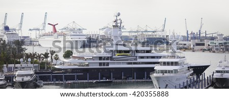 MIAMI - MAY 5: Image of Motoryacht Luna and Fountainhead docked at Watson Island Miami with Port Miami in the background shot with canon 5dsr May 5, 2016 in Miami FL - stock photo