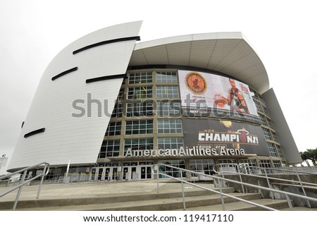 MIAMI - OCTOBER 26: the American Airlines Arena home to the Miami Heat, 2012 NBA champions , built in 1998 forms an impressive backdrop to the downtown Miami area on october 26, 2012, Miami, Florida - stock photo