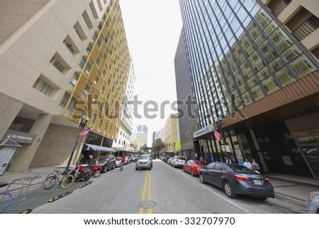 MIAMI - SEPTEMBER 25:Downtown Miami shot at Flagler Street facing east shot from midstreet September 25, 2015 in Miami FL, USA - stock photo