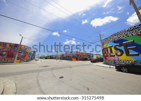 MIAMI - SEPTEMBER 3: Image of street art at Wynwood which is a neighborhood north of Downtown Miami and recognized by it's variety of grafiti on business walls September 3, 2015 in Miami FL - stock photo