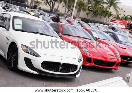 MIAMI - SEPTEMBER 26: Stock image of luxury exotic cars for sale at Prestige Imports in Miami September 26, 2013 in Miami, USA.  - stock photo
