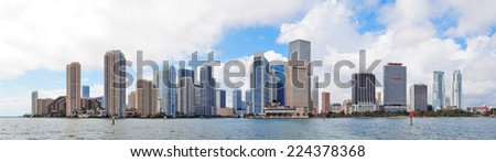 Miami skyline panorama in the day with urban skyscrapers and cloudy sky over sea