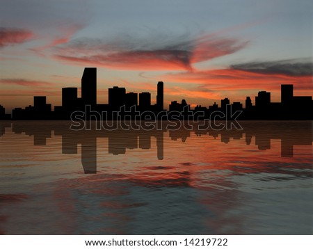 Miami Skyline reflected in water at sunset illustration - stock photo