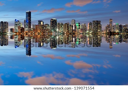 Miami Skyline seen from Key Biscayne at dusk with beautiful reflections - stock photo
