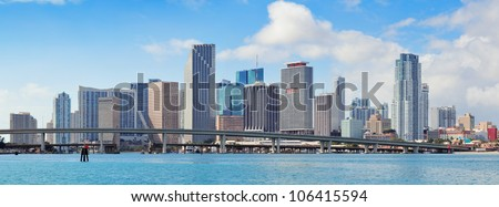 Miami skyscrapers with bridge over sea in the day. - stock photo