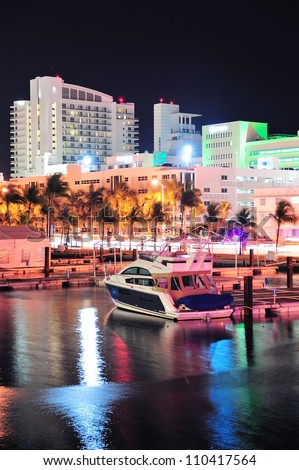 Miami south beach street view with water reflections at night - stock photo