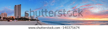 Miami South Beach sunrise panorama with hotels and colorful cloud and blue sky. - stock photo