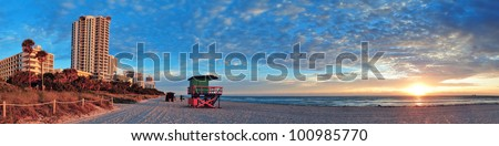 Miami South Beach sunrise with hotels and coastline with colorful cloud and blue sky. - stock photo