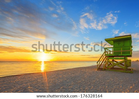 Miami South Beach sunrise with lifeguard tower - stock photo