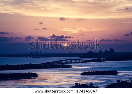 Miami sunset with Key Biscayne bridge and Coral Gables views