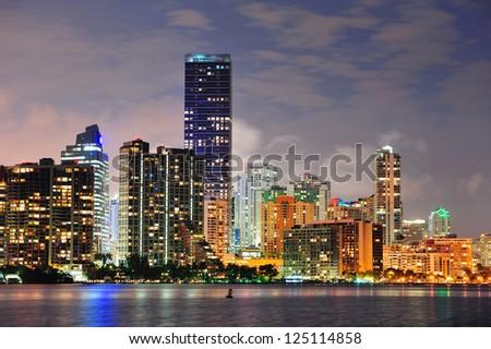 Miami urban architecture closeup over sea at night. - stock photo