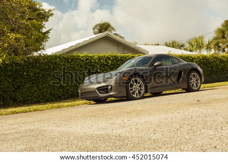 MIAMI, USA - APRIL 30, 2016: Full shot Porsche Cayman on APRIL 30, 2016 in Miami, USA.