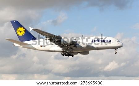 MIAMI, USA - April 29, 2015: Lufthansa Airbus A-380 jumbo jet landing in Miami. Lufthansa has started using these large jets on the popular route to Miami, Florida. - stock photo