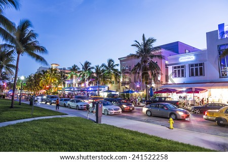 MIAMI, USA - AUG 19, 2014: Night view at Ocean drive  in Miami, USA. Art Deco Night-Life in South Beach at ocean drive is one of the main tourist attractions in Miami. - stock photo
