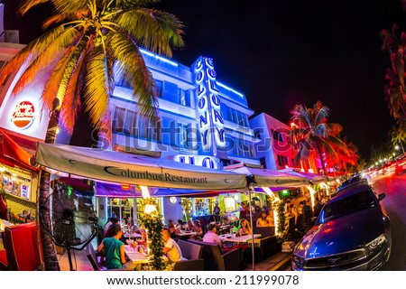 MIAMI, USA - AUG 19, 2014: people enjoy Ocean drive nightlife in  Miami, USA. Art Deco district architecture is one of the main tourist attractions in Miami. - stock photo