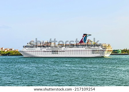 MIAMI, USA - AUGUST 18, 2014: Carnival Cruise Line, cruise ship Carnival Ectasy  Sails from Miami, USA to a cruise in the Carribean. - stock photo