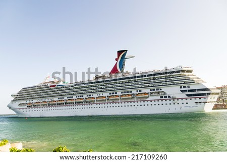 MIAMI, USA - AUGUST 18, 2014: Carnival Cruise Line, cruise ship Carnival Victory Sails from Miami, USA to a cruise in the Carribean. - stock photo
