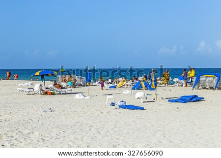 MIAMI, USA - AUGUST 18, 2014 : People enjoying the south beach  in Miami, USA. South Beach is one of the most famous beaches in the US. with spectacular white sand.