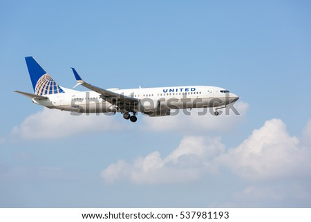 MIAMI, USA - DECEMBER 17, 2016: A United Airlines Boeing 737-800 aircraft landing at the Miami International Airport.