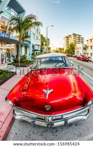 MIAMI, USA - July 31: classic Ford car parks in the art deco district on July 31, 2013 in Miami Beach, Florida. Art Deco Life in South Beach is one of the main tourist attractions in Miami. - stock photo