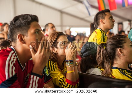 MIAMI, USA - July 04, 2014: Colombian fans  suffering at the final moments of the Brasil 2 x 1 Colombia match during the 2014 FIFA World Cup at Wynwood Art District, Miami, Florida. - stock photo