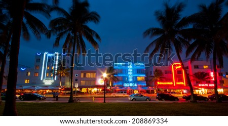 MIAMI, USA - JUNE 7, 2012: Palm trees and art deco hotels at Ocean Drive. The road is the main thoroughfare through South Beach. South Beach, Miami, Florida, United States of America, june 7 2012 - stock photo
