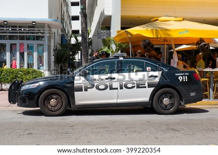 MIAMI, USA - MARCH 14, 2016: Police car parked in Ocean Drive in South Beach. - stock photo