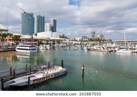 MIAMI, USA - NOVEMBER 25: Bayside Entertainment Market Place and Marina on a nice warm autumn day with the American Airlines Arena in the background at November 25, 2011.