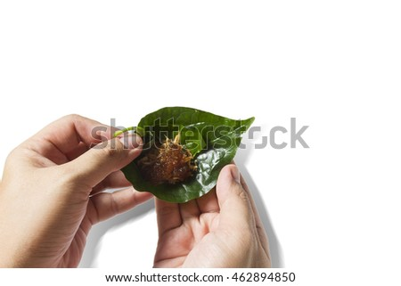 Miang Kham, Savoury Betel Leaf Wrap on hands with path isolated white background, Traditional herb dessert Thai Royal Cuisine Appetizer.