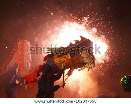 MIAOLI, TAIWAN -FEBRUARY 4 2012 - Bombing-dragon is hosted at the Lantern Festival in February4, 2012 in Miaoli. It is the Hakka people's traditional custom. - stock photo