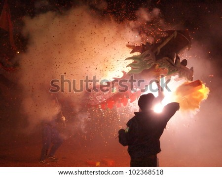 MIAOLI, TAIWAN - FEBRUARY 4 2012 - Bombing-dragon is hosted at the Lantern Festival in February4, 2012 in Miaoli. It is the Hakka people's traditional custom. - stock photo