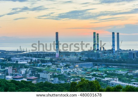 Miaoli, Taiwan- Jun 18, 2016: Thermal Power Plant and Wind Farm by the Ocean