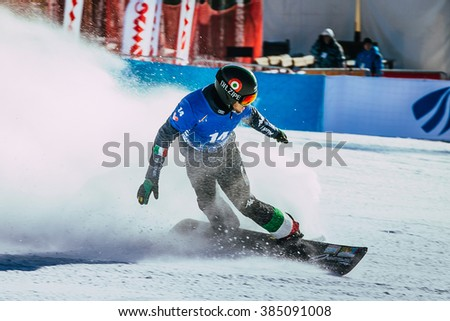 Miass, Russia - February 20, 2016: male snowboarder finish line after race during Snowboard World Cup - Snowboard Cross - stock photo
