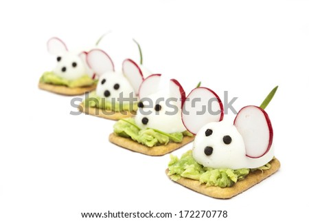 Mice made ??with eggs, pepper, radish and avocado paste - stock photo