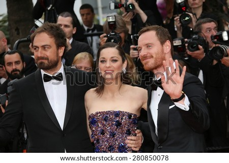 Michael Fassbender, Marion Cotillard and Director Justin Kurzel  attend the 'Macbeth' Premiere during the 68th annual Cannes Film Festival on May 23, 2015 in Cannes, France. - stock photo