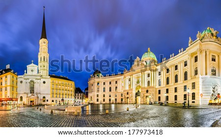 Michaelerplatz in Vienna, Austria at night with Hofburg and St. Michael's Church - stock photo